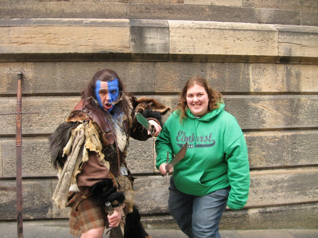 William Wallace impersonator and college girl holding swords.