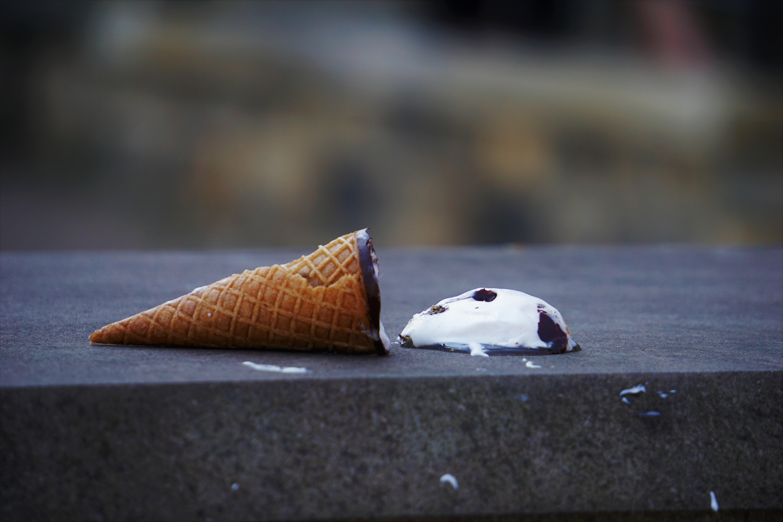 Ice cream cone fallen on concrete